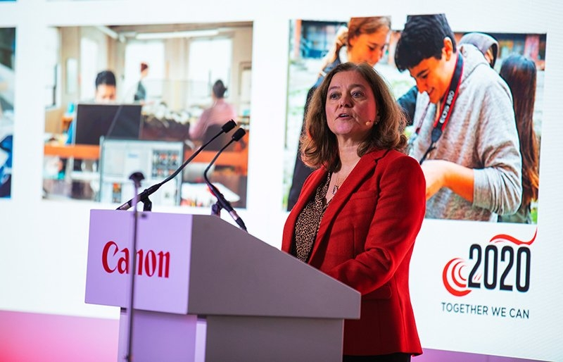 Caroline Price speaking at a Canon event